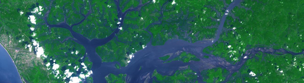 Clouds over a verdant river delta