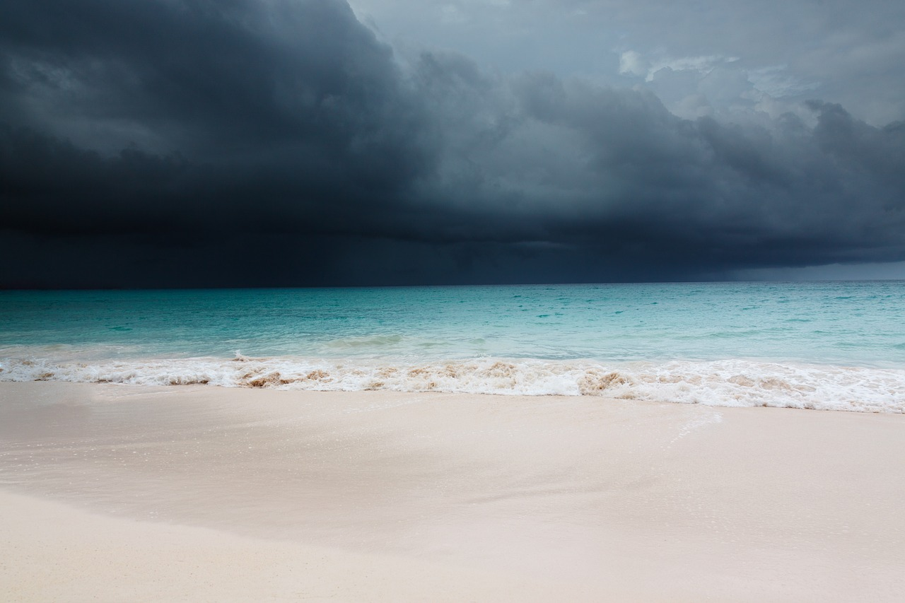 A storm approaches a Caribbean coastline