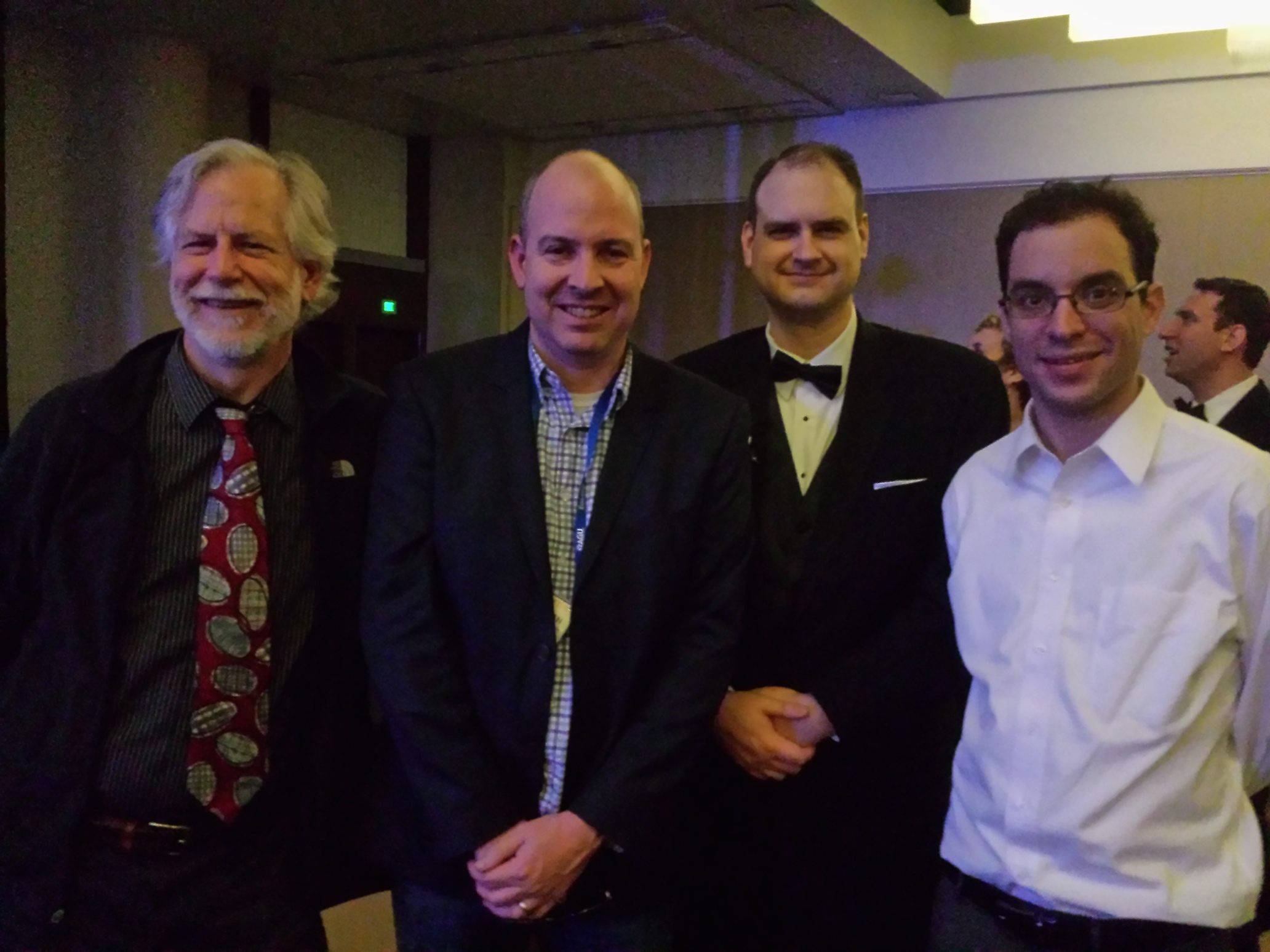 GCIS team members Robert Wolfe (left), Brian Duggan (center left), and Justin Goldstein (right), with Curt Tilmes (center right) at the AGU Awards Banquet.