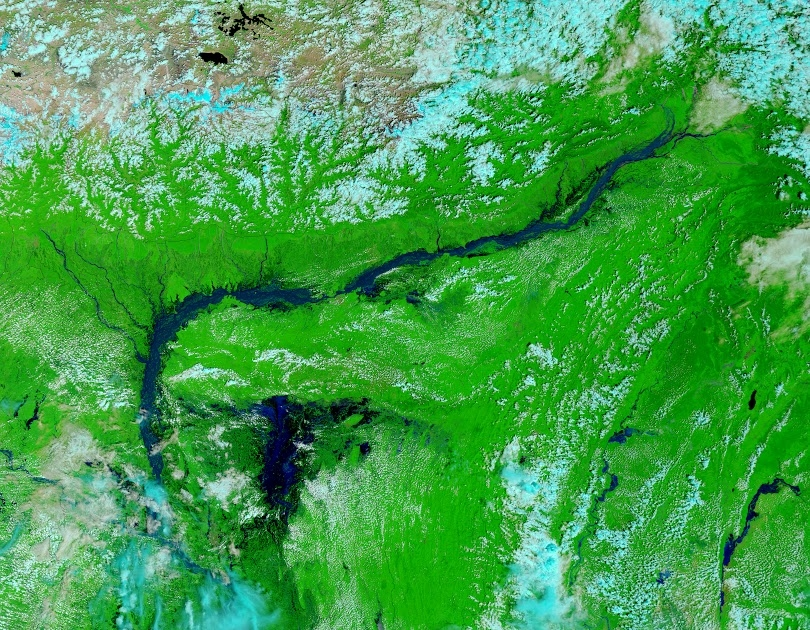 In the summer of 2014, heavy monsoon rains combined with the arrival of meltwater from the Himalayas to cause unusually severe flooding in parts of Bangladesh (shown above: the flooded Brahmaputra River valley and Tanquar Haor wetlands). SERVIR's flood fo