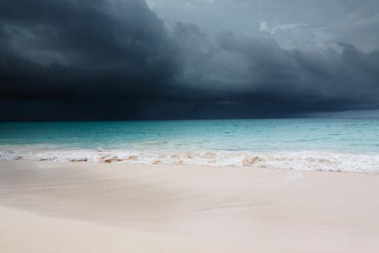 A storm approaches a Caribbean coastline