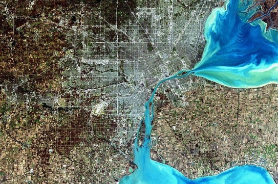 NASA satellite image of Detroit, MI, with the Detroit River, Lake St. Clair (top right), and Lake Erie (bottom right) in blue