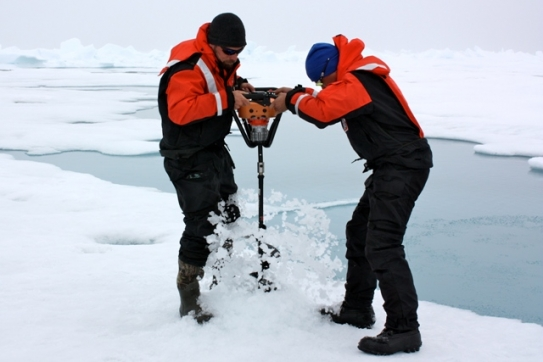 Researchers drilling into Arctic sea ice (NASA)